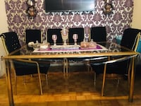 Dining table set tufted  6 chairs, like new no stain in the pictures is not clear it's very nice  In the pictures is not clear it's very nice one if you come see it in person I'm 100% sure you cannot find these for this price just $299. Mississauga, L5A 2G1