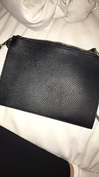 Black and gray leather wristlet Only has been used twice  Kitchener, N2C 0B5