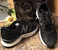 pair of black New Balance sneakers