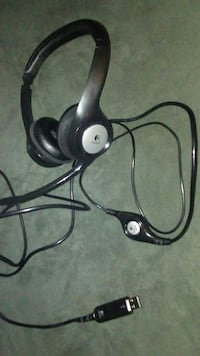 black and gray Logitech corded headset