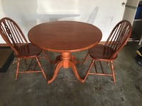 round brown wooden table with four chairs dining set Chantilly, 20151