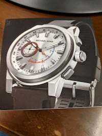 round silver-colored analog watch with black leather strap 370 mi