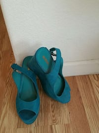 pair of blue open-toe wedge slingback sandals