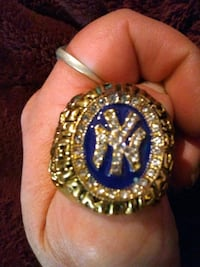 round gold-colored and blue ring San Antonio, 78217