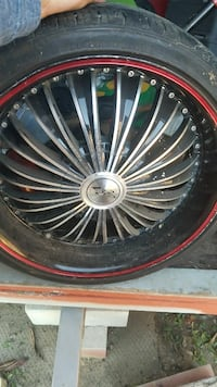 chrome multi-spoke car wheel with tire