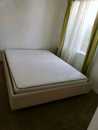white mattress and brown wooden bed frame Las Vegas, 89138