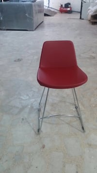 Red and stainless steel base chair