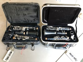 Black and gray clarinet with case