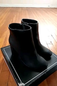 pair of black leather boots Wichita, 67218