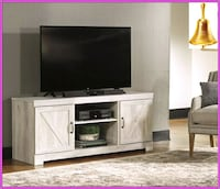 flat screen television and white wooden TV stand Katy