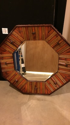 brown wooden octagon framed mirror