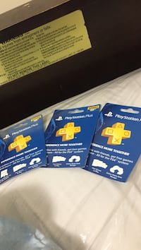 three Playstation Plus gift cards
