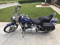 blue and black touring motorcycle 2215 mi