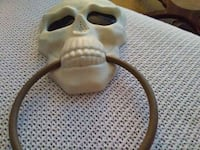 white and brown skull door knocker