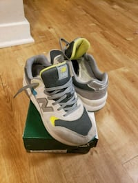 pair of gray-and-white Nike running shoes 44 km