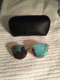 New Miami Beach metal framed blue lens sunglasses with case .  South Euclid, 44118