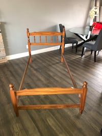 Brown wooden bed frame Mississauga, L5C 2M9