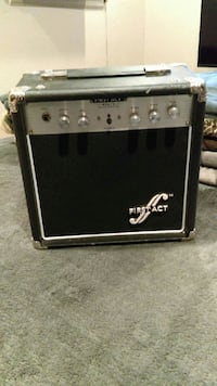 gray and black Firstact guitar amplifier