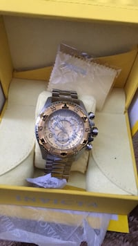 round silver Invicta chronograph watch with link bracelet Los Angeles, 90028