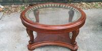 oval brown wooden framed glass-top coffee table Houston, 77009