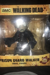 The walking dead prison guard vinyl figure