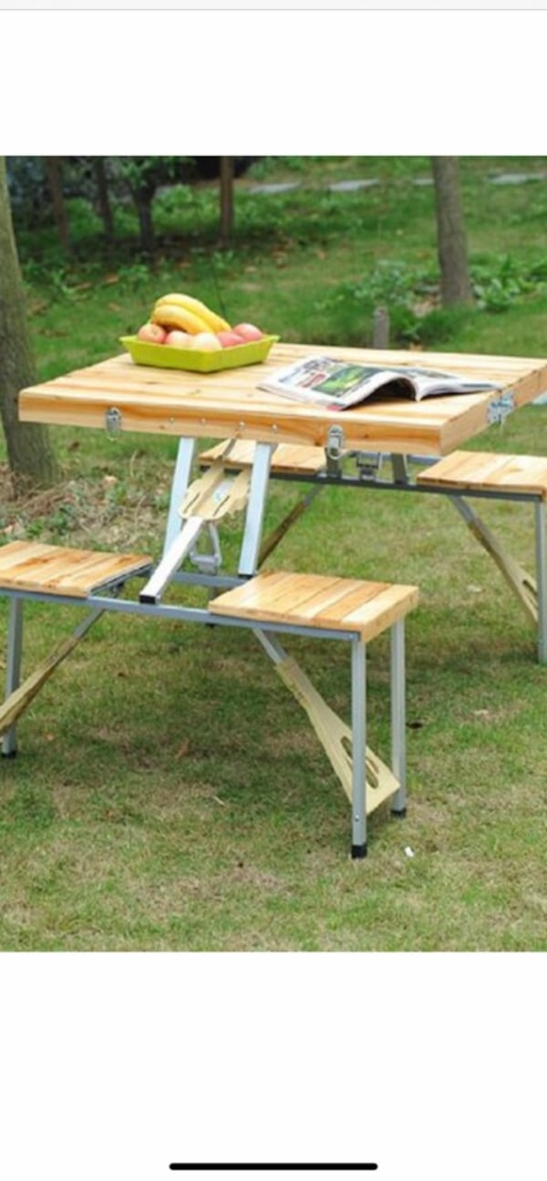 Small folding picnic table.  604fe781-9ed0-4b93-9ed9-84a05ca6b9b4