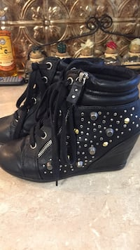 pair of black leather studded booties
