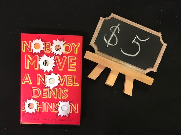 brown and black Easel;' No body Move book by Denis johnson