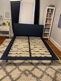 Queen upholsteres navy bed. Platform bed in like new condition.