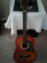 red and black classical guitar Orlando, 32835