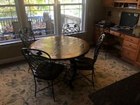round brown wooden table with four chairs Lorton, 22079