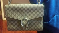 white and gray Coach monogram leather wristlet null