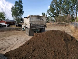 Dirt ( We deliver in dump trucks, No charge)
