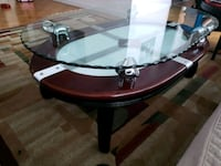 round brown wooden framed glass top table Toronto, M1J 3E2