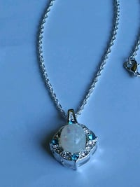 White Fire Opalpal and Blue Cz Necklace. Mount Pleasant, 48858