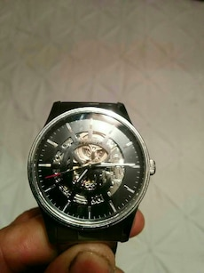 black mechanical watch with black leather bracelet