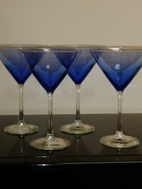 four clear-and-blue martini glasses