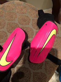 pair of red-and-black Nike cleats Cambridge, N1T 2J1