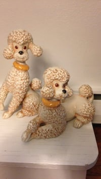 Two white toy poodle ceramic figurines