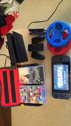 black Nintendo Switch with games and controller