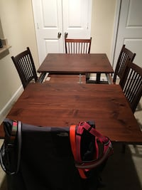 Wooden extension dining table 6 chairs, other chair is in a room Herndon, 20171