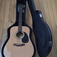 Brown and black dreadnought acoustic guitar in black case 216 mi