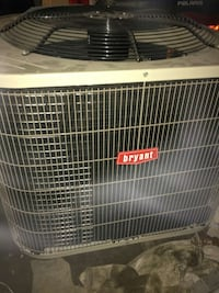 white and black Bryant outdoor AC unit