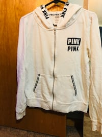 PINK White zip up sweatshirt. Strings are missing is the only reason for selling cheap. $7 is firm. Size small- fits more like a medium in my opinion.  Saint Cloud, 56301