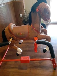 Rocking rider wrangler horse.bounces up and down and back and forth.