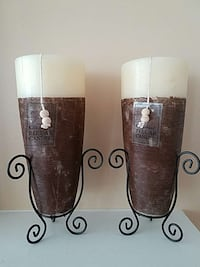 two black metal candle holders with brown and white pillar candles Aldie, 20105