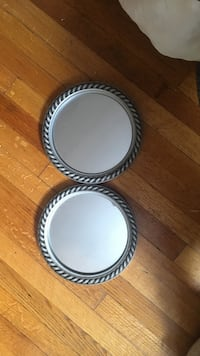 two round silver framed wall mirrors