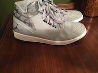 pair of white and gray Air Jordan mid-top sneakers