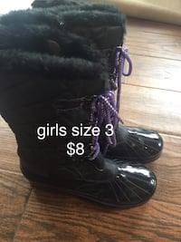 pair of black leather boots Utica