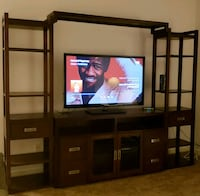 brown wooden TV hutch with flat screen television Sandy Springs, 30328
